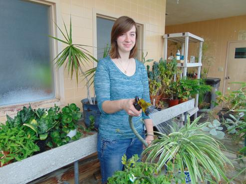 SLC student with plants