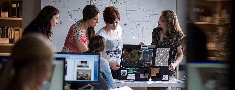 Students and professor in computer lab